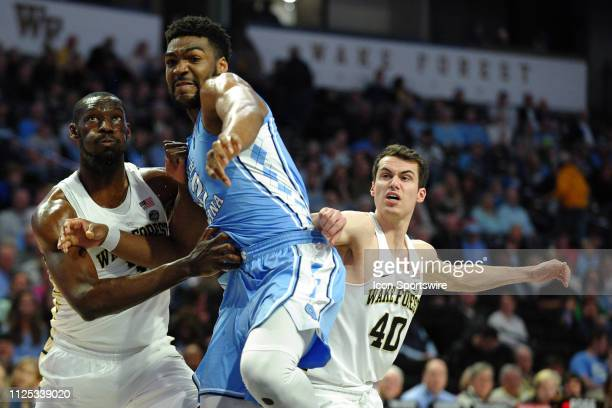 Wake Forest Demon Deacons forward Sunday Okeke and guard Anthony Bilas tries to box out North Carolina Tar Heels forward Brandon Huffman after a free...