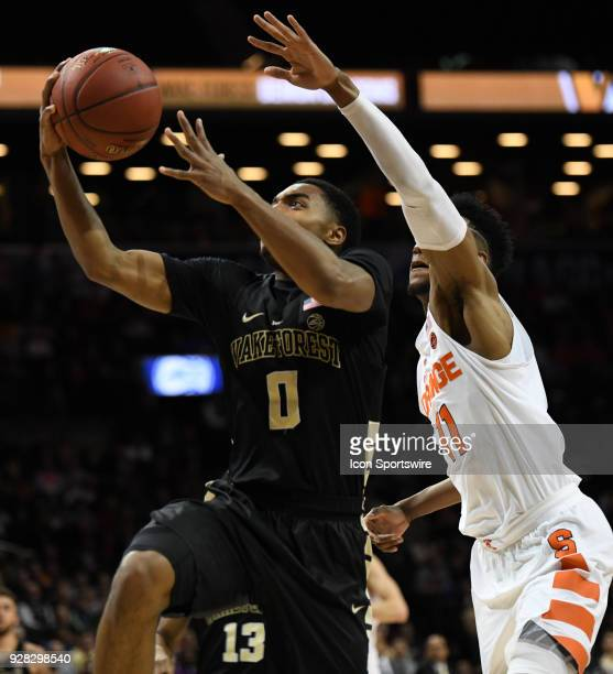 Wake Forest Demon Deacons guard Brandon Childress lays up on a fast break in front of Syracuse Orange forward Oshae Brissett during the ACC men's...