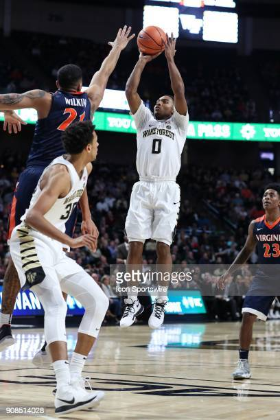 Wake Forest Demon Deacons guard Brandon Childress shoots a jumper over Virginia Cavaliers forward Isaiah Wilkins during the ACC matchup on January 21...
