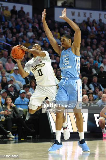 Wake Forest Demon Deacons guard Brandon Childress tries to draw the foul on North Carolina Tar Heels forward Garrison Brooks on this play during the...