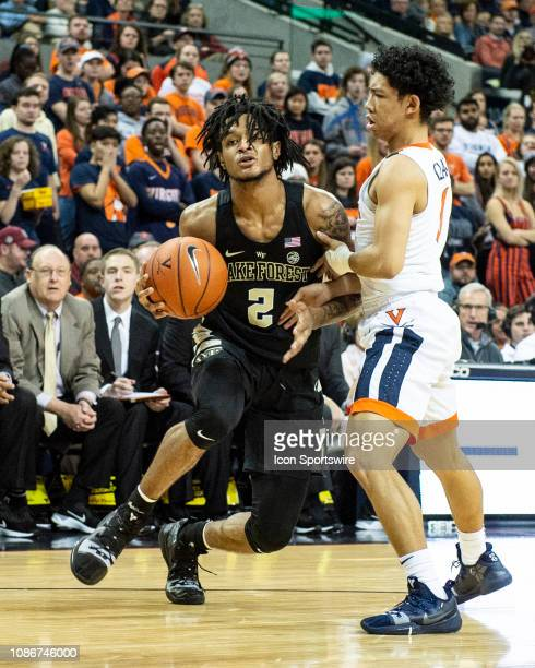 Wake Forest Demon Deacons Guard Sharone Wright Jr drives the ball against Virginia Cavaliers Guard Kihei Clark during the second half of the Wake...