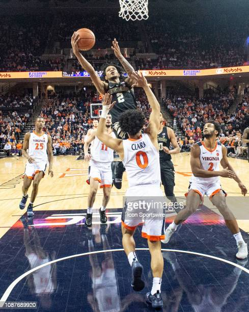 Wake Forest Demon Deacons Guard Sharone Wright Jr leaps for the basket with Virginia Cavaliers Guard Kihei Clark defending during the second half of...