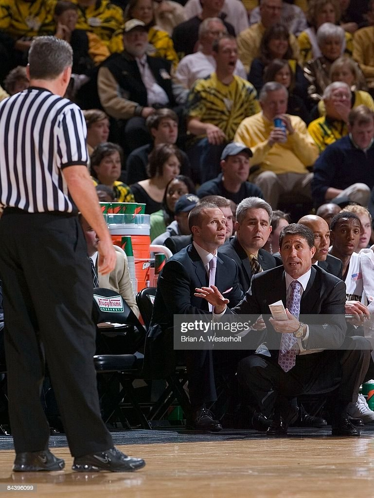 Wake Forest Demon Deacons head coach Dino Gaudio discusses a call with referee Jamie Luckie during the first half against the North Carolina Tar Heels at the LJVM Coliseum January 11, 2009 in Winston-Salem, North Carolina. The Demon Deacons defeated the Tar Heels 92-89.