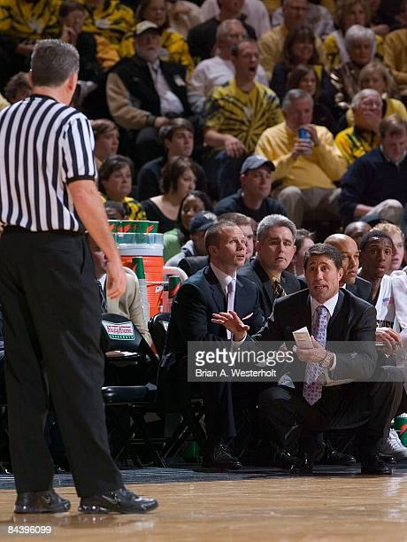 Wake Forest Demon Deacons head coach Dino Gaudio discusses a call with referee Jamie Luckie during the first half against the North Carolina Tar...