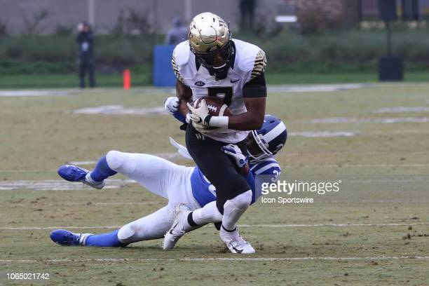 Wake Forest Demon Deacons punter Dom Maggio with the ball while Duke Blue Devils safety Brandon Feamster tries to tackle him during the 1st half of...