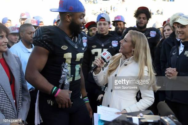 Wake Forest Demon Deacons quarterback Jamie Newman is interviewed by ESPN reporter Dawn Davenport after the Birmingham Bowl between the Memphis...