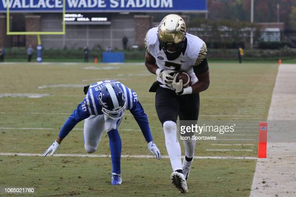 Wake Forest Demon Deacons wide receiver Greg Dortch scores a touchdown with Duke Blue Devils safety Brandon Feamster behind him during the 1st half...