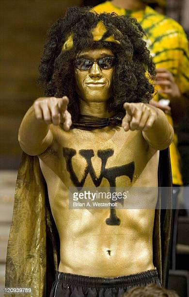 A Wake Forest fan shows his team spirit prior to the start of the Demon Deacons game versus North Carolina at the LJVM Coliseum in WinstonSalem NC...