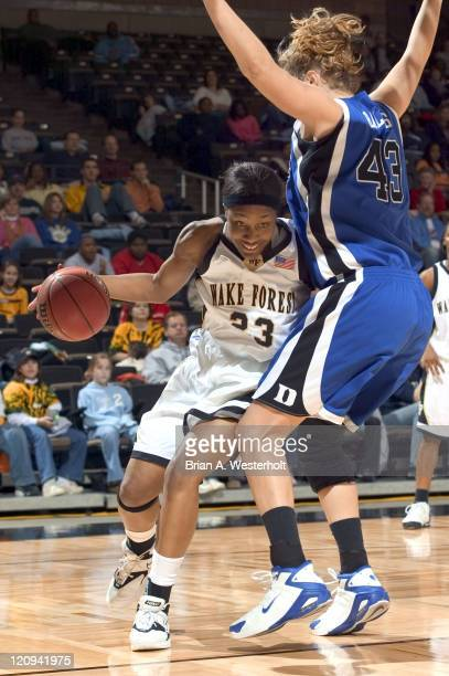 Wake Forest forward Keila Evans tries to drive the baseline past Duke center Alison Bates during first half action at the LJVM Coliseum in...