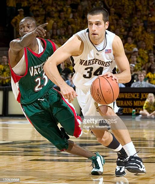 Wake Forest forward Michael Drum drives the lane past Mississippi Valley State forward Mike Thomas during second half action in the 2K Sports College...