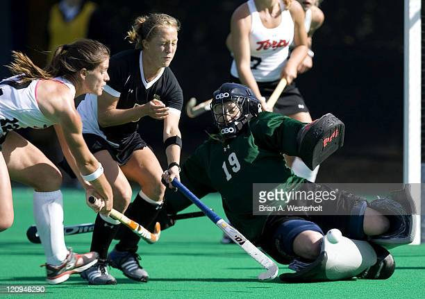 Wake Forest goalie Crystal Duffield makes a sliding save versus Maryland's Paula Infante late in the second half to help preserve the Demon Deacons...