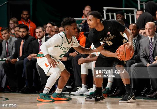 Wake Forest guard Brandon Childress is guarded by Miami guard Chris Lykes during a college basketball game between the Wake Forest University Demon...