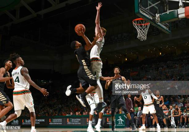 Wake Forest guard Brandon Childress shoots against Miami forward Sam Waardenburg during a college basketball game between the Wake Forest University...