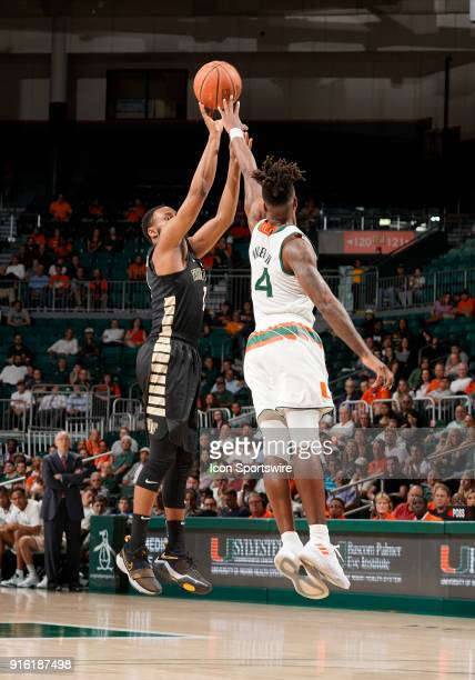 Wake Forest guard Brandon Childress shoots against Miami guard Lonnie Walker IV during a college basketball game between the Wake Forest University...
