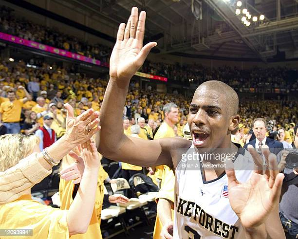 Wake Forest guard Chris Paul celebrates with fans following the game Wake Forest defeated North Carolina 9582 at Lawrence Joel Coliseum in...