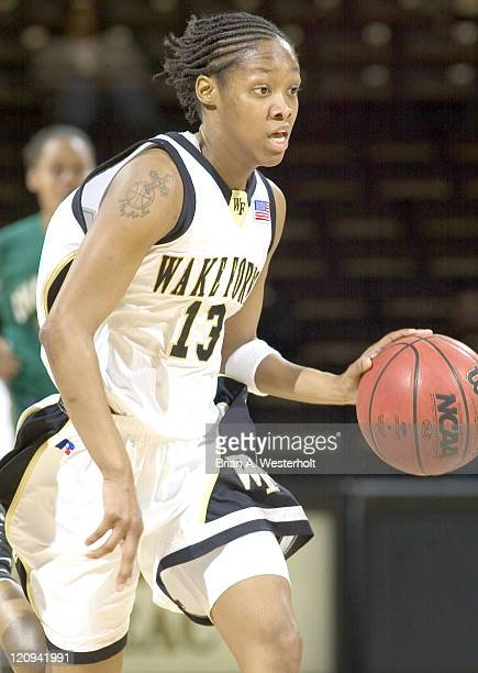 Wake Forest guard Cotelia BondYoung pushed the ball up court on a fast break versus Charlotte during the first round of the 2005 Women's NIT at the...