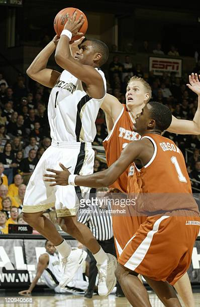 Wake Forest guard Justin Gray drives the lane past Texas' Daniel Gibson and Jason Klotz during first half action at the LJVM Coliseum in...