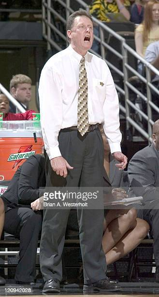 Wake Forest head coach Mike Petersen yells out instructions to his Demon Deacons during second half action versus the Charlotte 49'ers in the first...