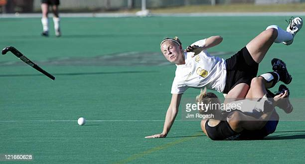 Wake Forest midfielder Kelly Dostal flips over Duke back Kim Gogola during the NCAA Field Hockey Championship at the Univeristy of Massachusetts in...