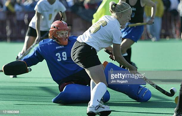 Wake Forest midfielder Kelly Dostal tries to get by Duke goalkeeper Christy Morgan during the NCAA Field Hockey Championship at the Univeristy of...
