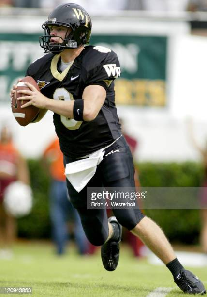 Wake Forest QB Ben Mauk rolls out looking to pass during first half action at Groves Stadium as Wake Forest came up short against Virginia Tech,...