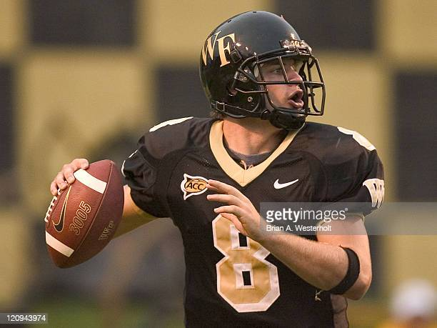 Wake Forest QB Benjamin Mauk looks for an open receiver as he scrambles out of the pocket late in the second half of play versus Maryland at Groves...