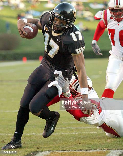 Wake Forest QB Cory Randolph breaks the grasp of Maryland LB D'Qwell Jackson to score on a 5 yard run during the second quarter of the Demon Deacons...