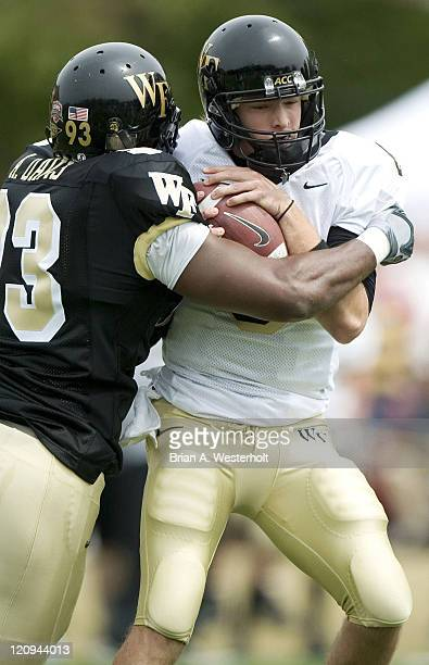 Wake Forest quarterback Brett Hodges is sacked by Anthony Davis during the Spring Game on the campus of Wake Forest University in Winston-Salem,...