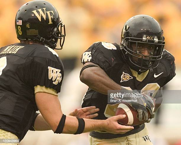 Wake Forest RB Chris Barclay takes a hand-off from QB Benjamin Mauk during first half action versus Maryland at Groves Stadium in Winston-Salem, NC,...