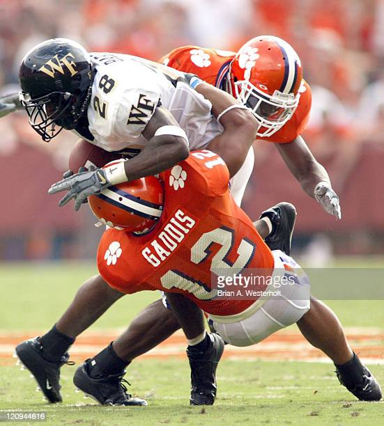 Wake Forest runningback Chris Barclay is brought down by Clemson cornerback C. J. Gaddis and defensive back Tramaine Billie at Memorial Stadium in...
