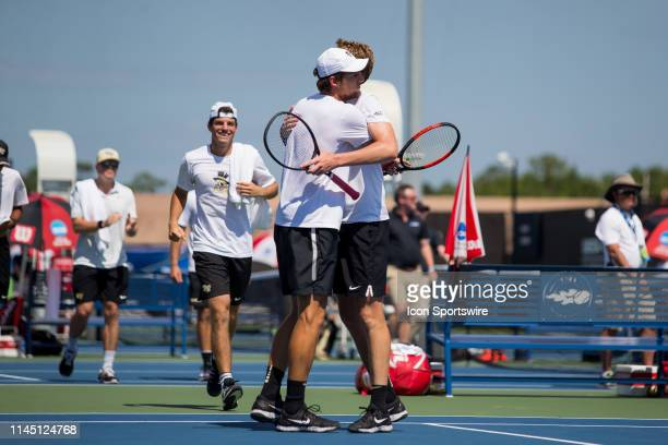 Wake Forest tennis player Borna Gojo hugs doubles partner Alan Gadjiev after winning the doubles point in the championship round of the NCAA Division...