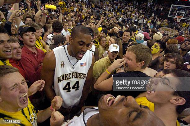 Wake Forest's David Weaver and teammate LD Williams celebrate with fans following an 8673 win against Duke at Lawrence Joel Veterans Memorial...