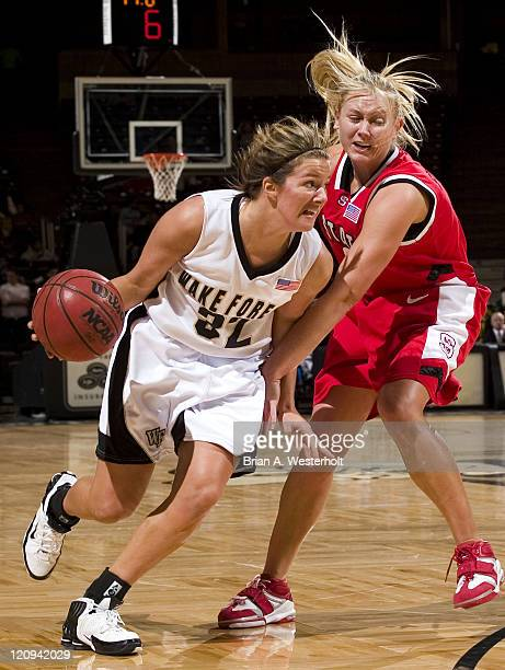 Wake Forest's Deirdre Naughton drives past North Carolina State's Rachel Stockdale during first half action at the Joel Coliseum in Winston-Salem,...