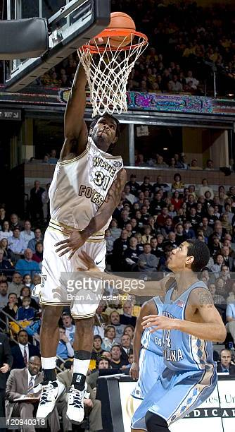 Wake Forest's Eric Williams dunks home two of his 15 first half points over North Carolina's Danny Green at the LJVM Coliseum in WinstonSalem North...