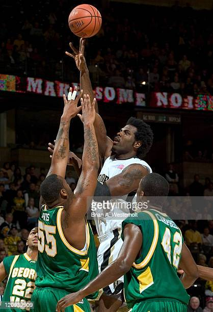 Wake Forest's Eric Williams floats a shot over George Mason's Jai Lewis during first half action in the 2K Sports College Hoops Classic at the LJVM...