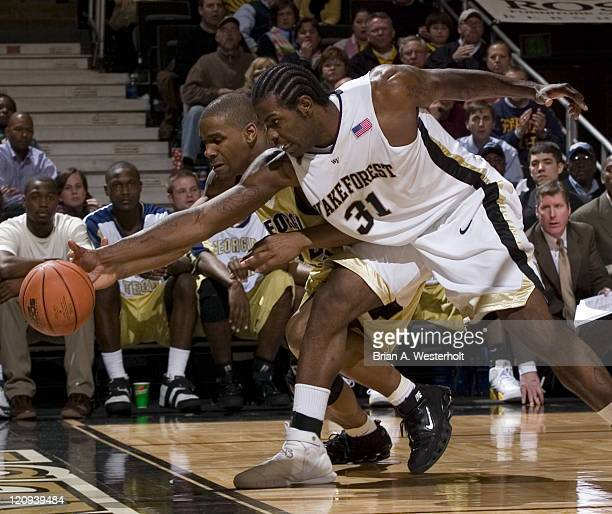 Wake Forest's Eric Williams tries to save the ball from going out of bounds in front of Georgia Tech's Jeremis Smith during second half action at the...
