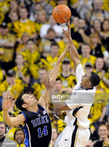 Wake Forest's Jeff Teague lofts a shot over Duke's David McClure during the first half at Lawrence Joel Coliseum in WinstonSalem North Carolina...