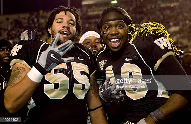 Wake Forest's Jyles Tucker and Bryan Andrews celebrate after defeating Boston College 2114 at Groves Stadium in WinstonSalem NC Saturday November 4...
