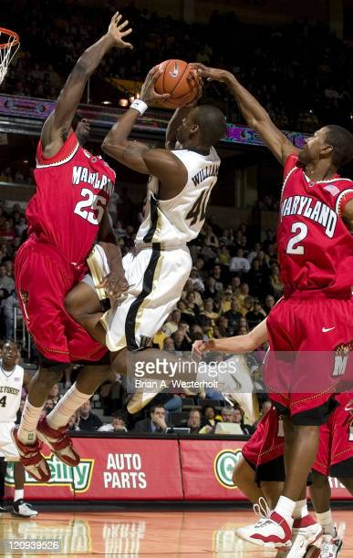 Wake Forest's L.D. Williams tries to score between Maryland's Ekene Ibekwe and D.J. Strawberry during first half action at the LJVM Coliseum in...