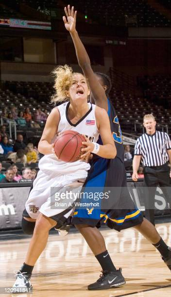 Wake Forest's Liz Strunk drives to the basket past Coppin State's Danielle Andres during second half action at the LJVM Coliseum in Winston-Salem,...