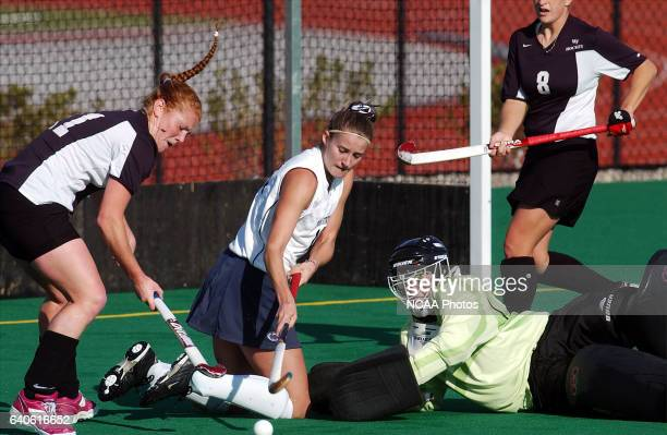 Wake Forest's Lucy Shaw Lynn Shenk and goalie Katie Ridd clamp down on Timarie Legel of Penn State during the Division I Women's Field Hockey...