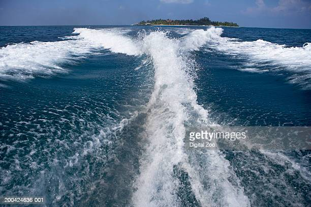 Wake from outboard motorboat on surface of Indian Ocean
