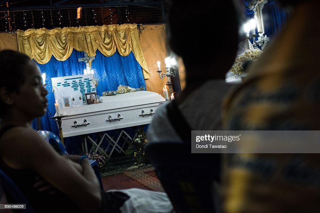 A wake is held for two victims of extrajudicial killings on December 24, 2016 in Manila, Philippines. Philippine president Rodrigo Duterte has said he wanted the Constitution amended to allow Philippine leaders to wield martial law powers without judicial and congressional approval, a move he said is necessary to contain the ongoing 'drug menace' and maintain peace and security in the country. Around 5,882 people have been killed across the country since President Rodrigo Duterte launched his war on illegal drugs five months ago, according to figures from the Philippine National Police. An average of 25 victims were killed daily during the five-month period, and police kill 97 percent of those they shoot, leaving 33 dead for every person wounded according to the figures. Last October, Duterte himself said the country could expect about 20,000 or 30,000 more deaths in his administration's bloody war on drugs.
