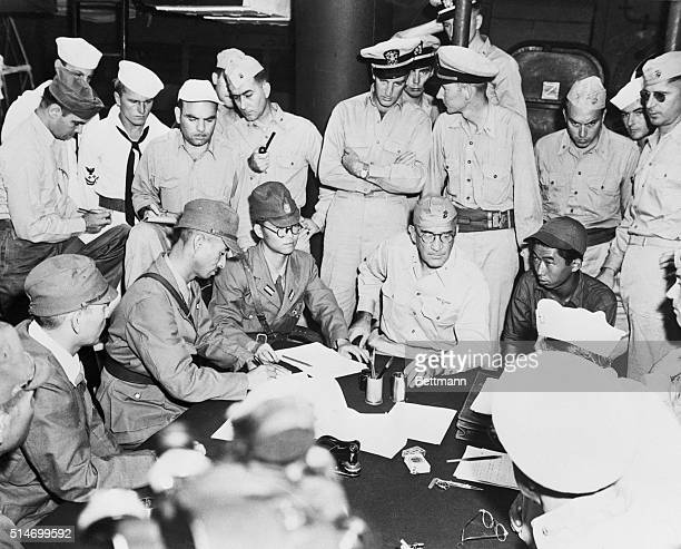 Admiral Sakaibara signs surrender document for Japan