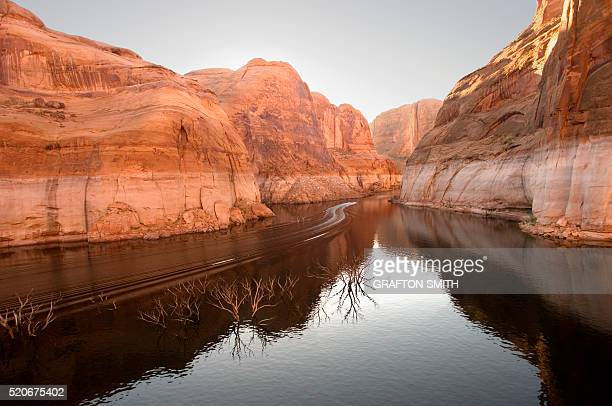 Wake of a Motorboat in a Quiet Canyon