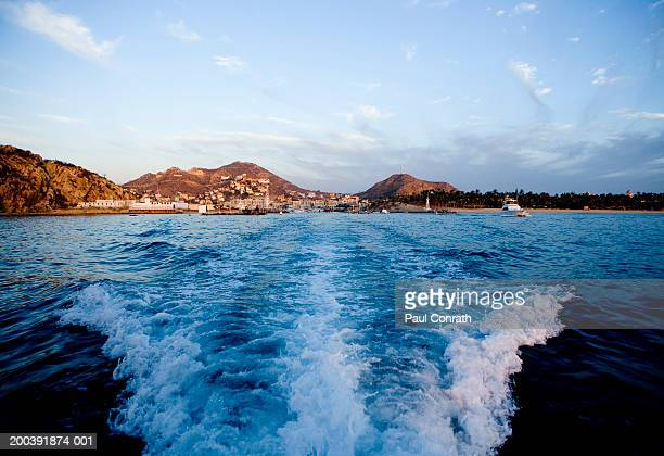 Wake of boat leaving harbor, dawn, Cabo San Lucas, Mexico