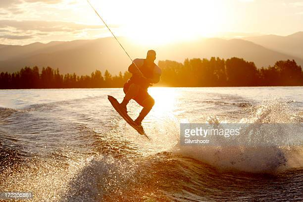 wakeboarder at sunrise - waterskiing stock photos and pictures