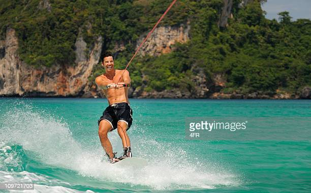 wakeboarding on tropical waters (xxxl) - waterskiing stock photos and pictures