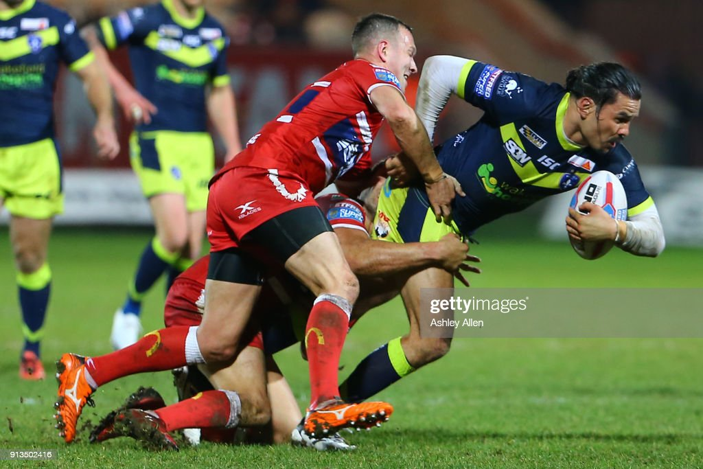 Wakefield Trinity's Justin Horo (R) is tackled by Hull KR's Danny McGuire (L) during the BetFred Super League match between Hull KR and Wakefield Trinity at KCOM Craven Park on February 2, 2018 in Hull, England