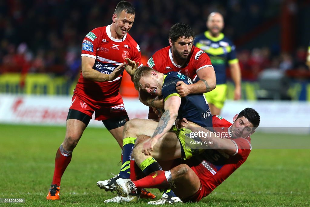 Wakefield Trinity's Kyle Wood (C) is tackled by Hull KR's Danny McGuire (L),Lee Jewitt (C) and Chris Clarkson (R) during the BetFred Super League match between Hull KR and Wakefield Trinity at KCOM Craven Park on February 2, 2018 in Hull, England